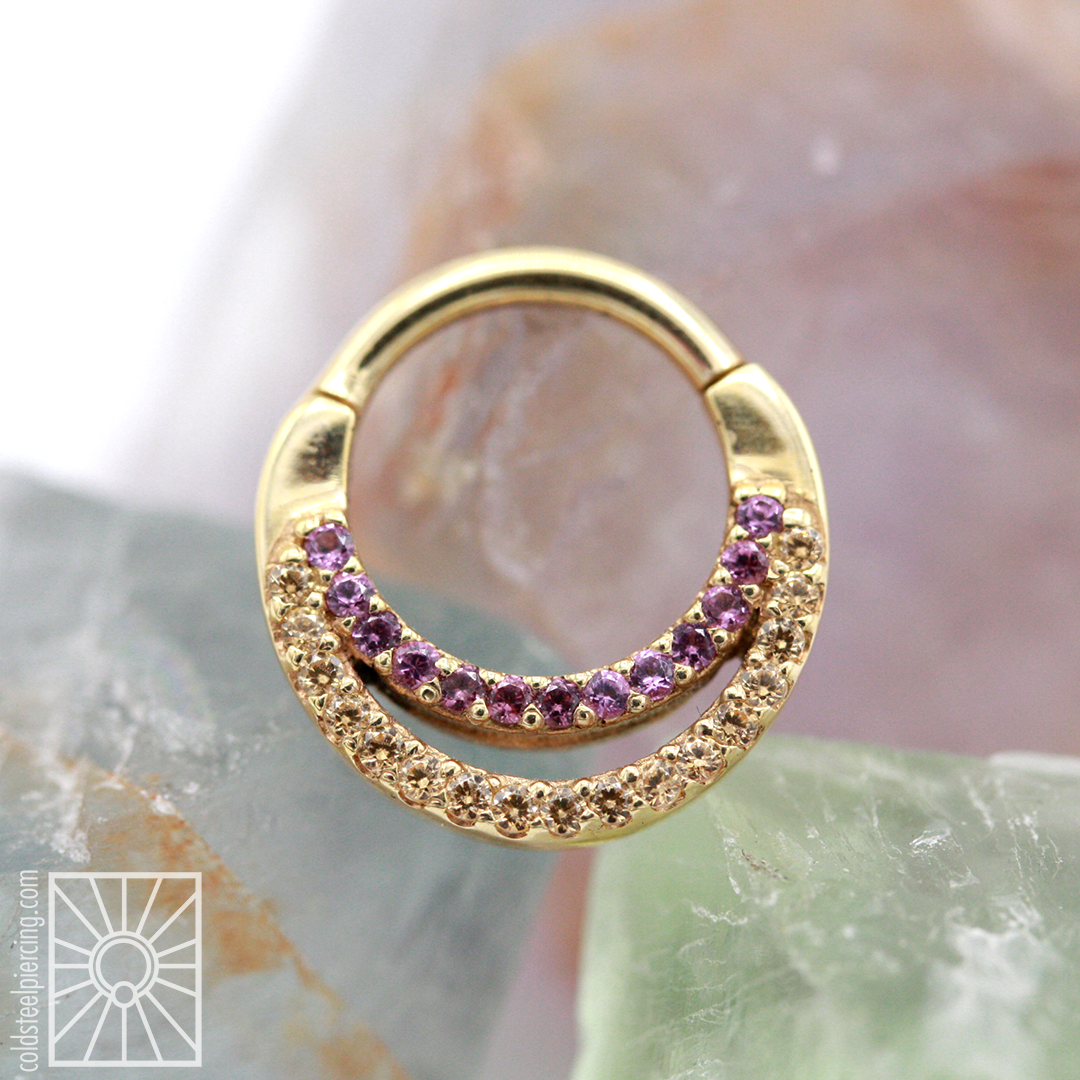 """The fantastic folks at Body Vision Los Angeles never fail to impress! This gorgeous piece is the """"Janesca"""" in solid 14 karat Yellow Gold, with genuine AA Rhodolite and Champagne CZ's. This piece features a hinge closure, making it easier to install and remove by yourself. Simply beautiful."""