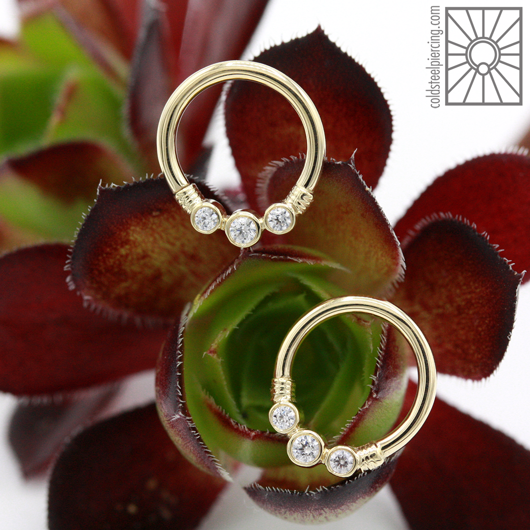 """14k Yellow Gold """"Faraway"""" continuous rings with clear cz's from Body Vision Los Angeles."""