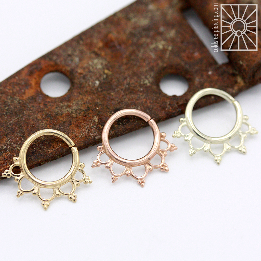"""The """"Anoora"""" continuous ring in solid Yellow, Rose, and White gold from Buddha Jewelry Organics , in stock and ready to fancy up some septum, daith, and helix piercings! Available in the studio and our online store."""