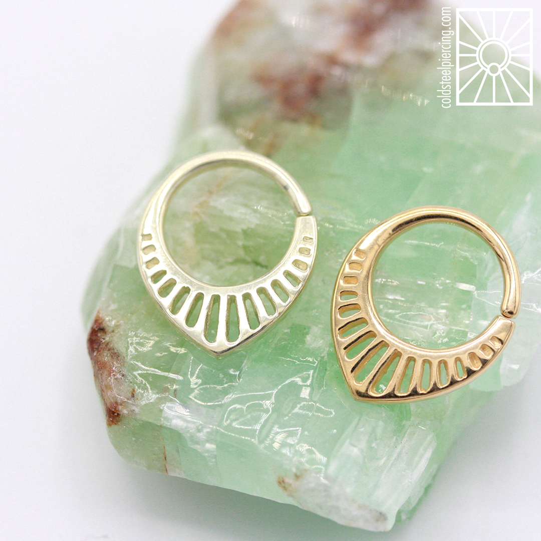 """The """"Triumph"""" ring in solid White and Yellow Gold from Buddha Jewelry Organics , so cute and perfect for septum and daith piercings! Available in the studio and our online store."""