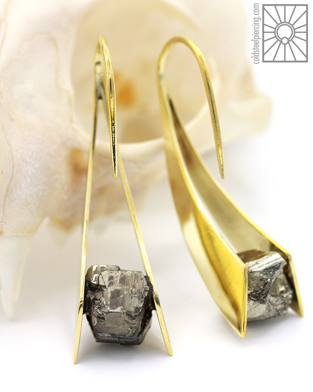 """Looking to make a statement with your next jewelry addition? These beautifully unique brass and Pyrite """"Zahara"""" pieces from Buddha Jewelry Organics are sure to do just that! Available in the studio and our online store."""