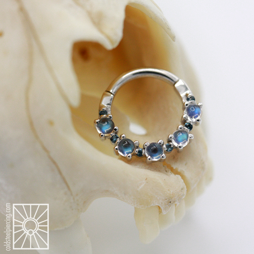 """The """"Setevos"""" hinged ring from Body Vision Los Angeles, such a gorgeous combination of White Gold and genuine Rainbow Moonstone! Available in the studio and our online store."""