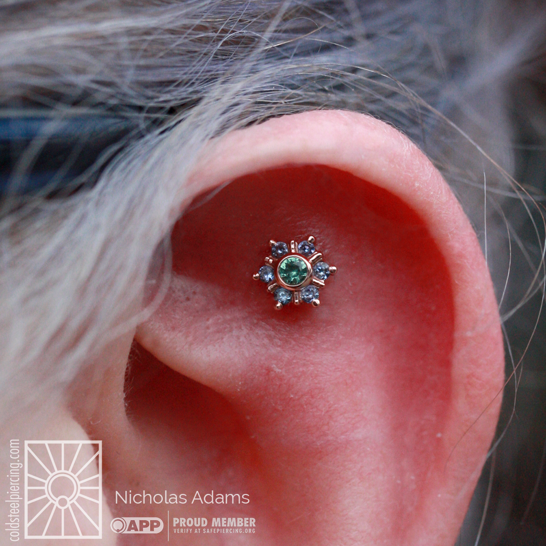 """Gotta love when new pretties get snapped up before we've even had a chance to post it! Nicholas did a faux rook piercing for this lovely woman during his visit, but recently her jewelry got pulled out - oh no! Luckily we were able to get something back in there, and we love that she chose this breathtaking piece: Rose Gold """"Mini Toltec"""" featuring genuine Polar Sapphires and Seafoam Tourmaline, SO GORGEOUS! Jewelry from Body Vision Los Angeles, of course."""