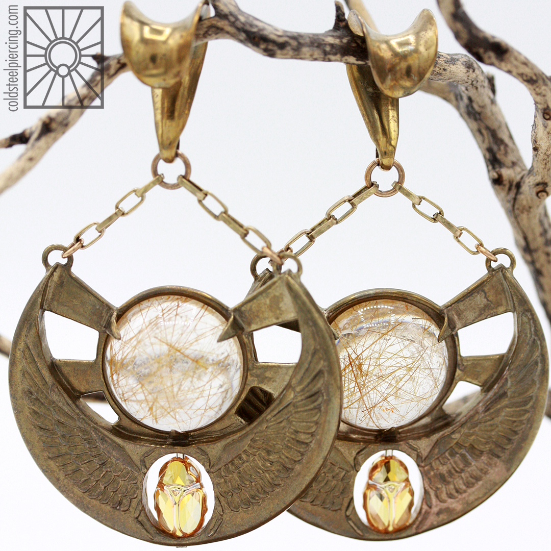 Fantastic set of brass and Rutilated Quartz scarab beetle ear weights from Phoenix Revival Jewelry.