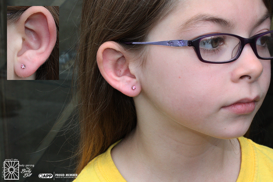 Becky pierced this lovely youngster's earlobes a couple weeks ago and she did so well! Her choice of 3mm pink cz's were perfect, so cute.