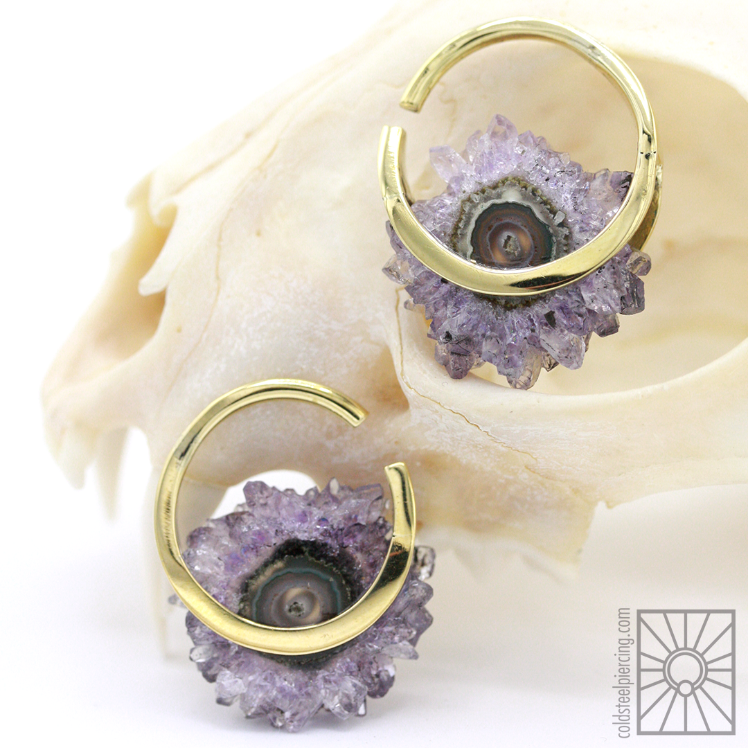 """We are so happy we got our hands on a set of these beautiful brass and amethyst """"Halo"""" weights from Buddha Jewelry Organics! These little cuties are for 12g or larger earlobes, and they measure in at an adorable 1 1/8"""" tall - mini but mighty!"""
