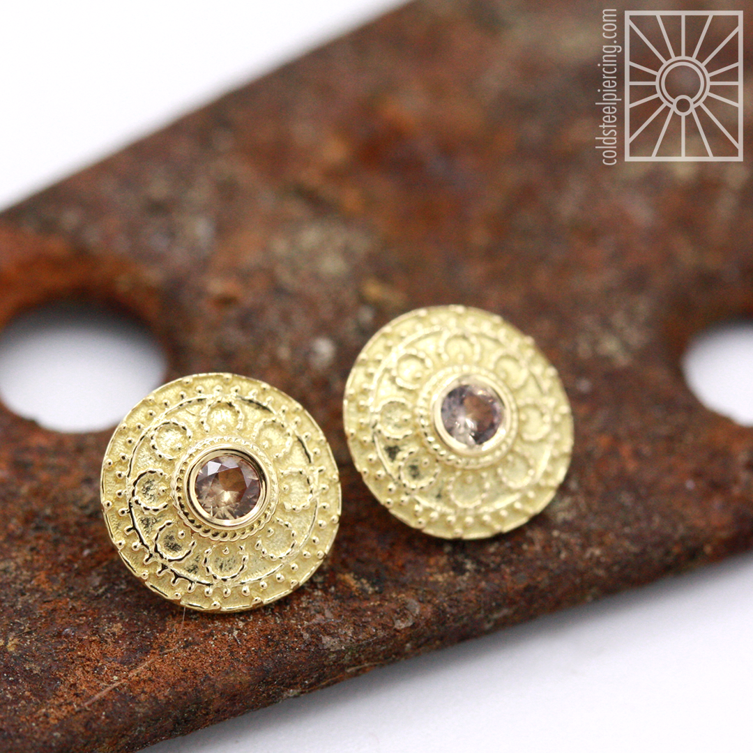 """Breathtaking set of Body Vision Los Angeles """"Nanda"""" ends for a wonderful client of ours - 18k yellow gold with some beautifully blushy Champagne Sapphires ."""