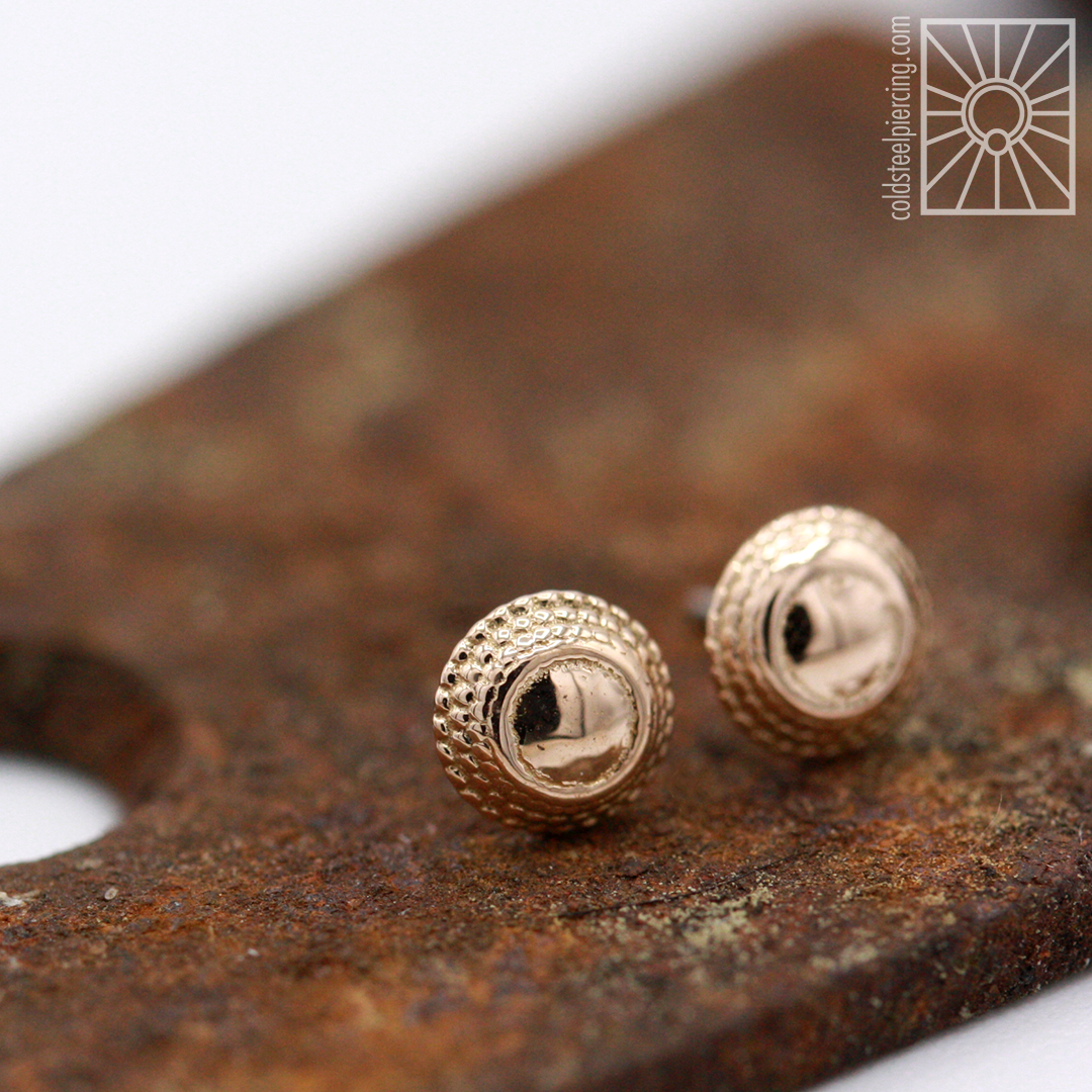"""Beautiful set of 18k rose gold """"Hera"""" ends from Anatometal for our own Shana's paired nostril piercings!"""