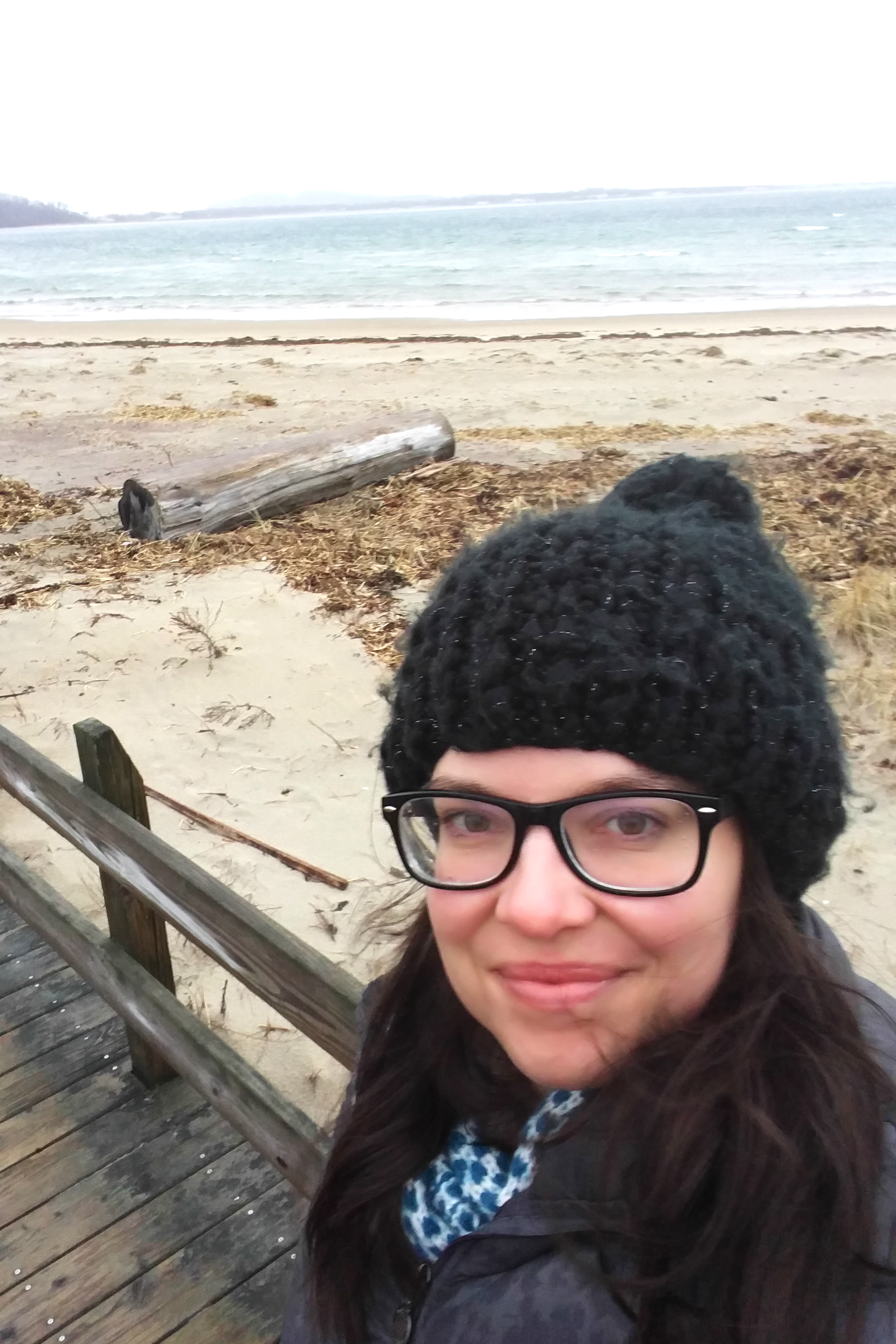 630am. No makeup, still half in my pajamas, but there I am with some coffee,the beach and the sunrise in the cold New England rain.