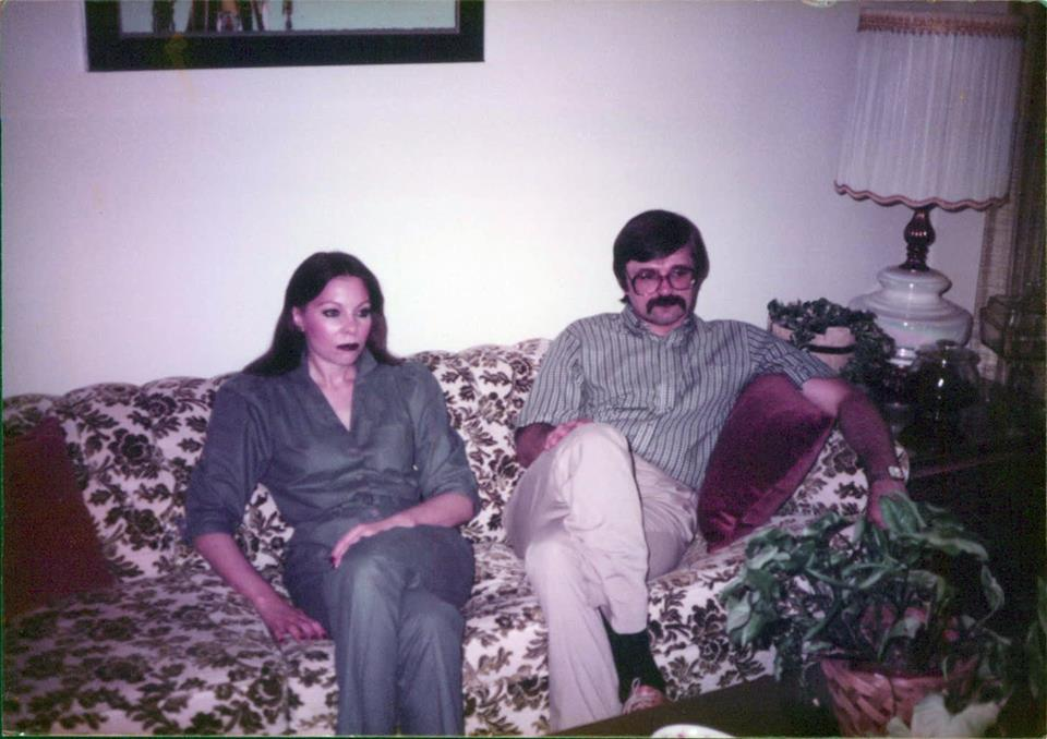 I love this picture. My parents look thrilled here. What is their body language saying?