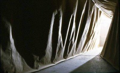 "Hallway  hallway altered with paper, hot glue, cardboard, string 70 x 94 x 602"" 2003"