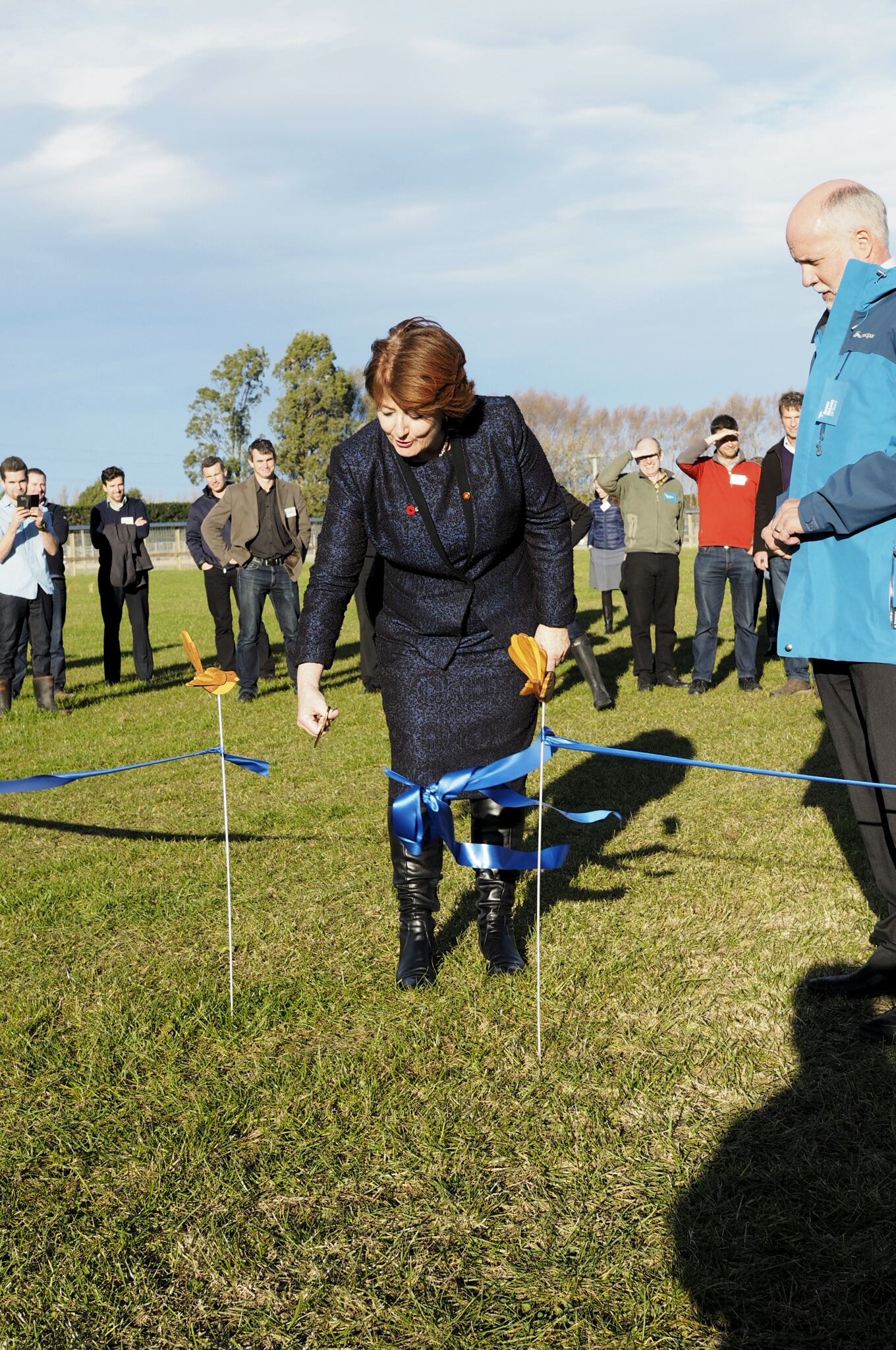 Hon Maggie Barry cuts a ribbon to officially open the new facility.