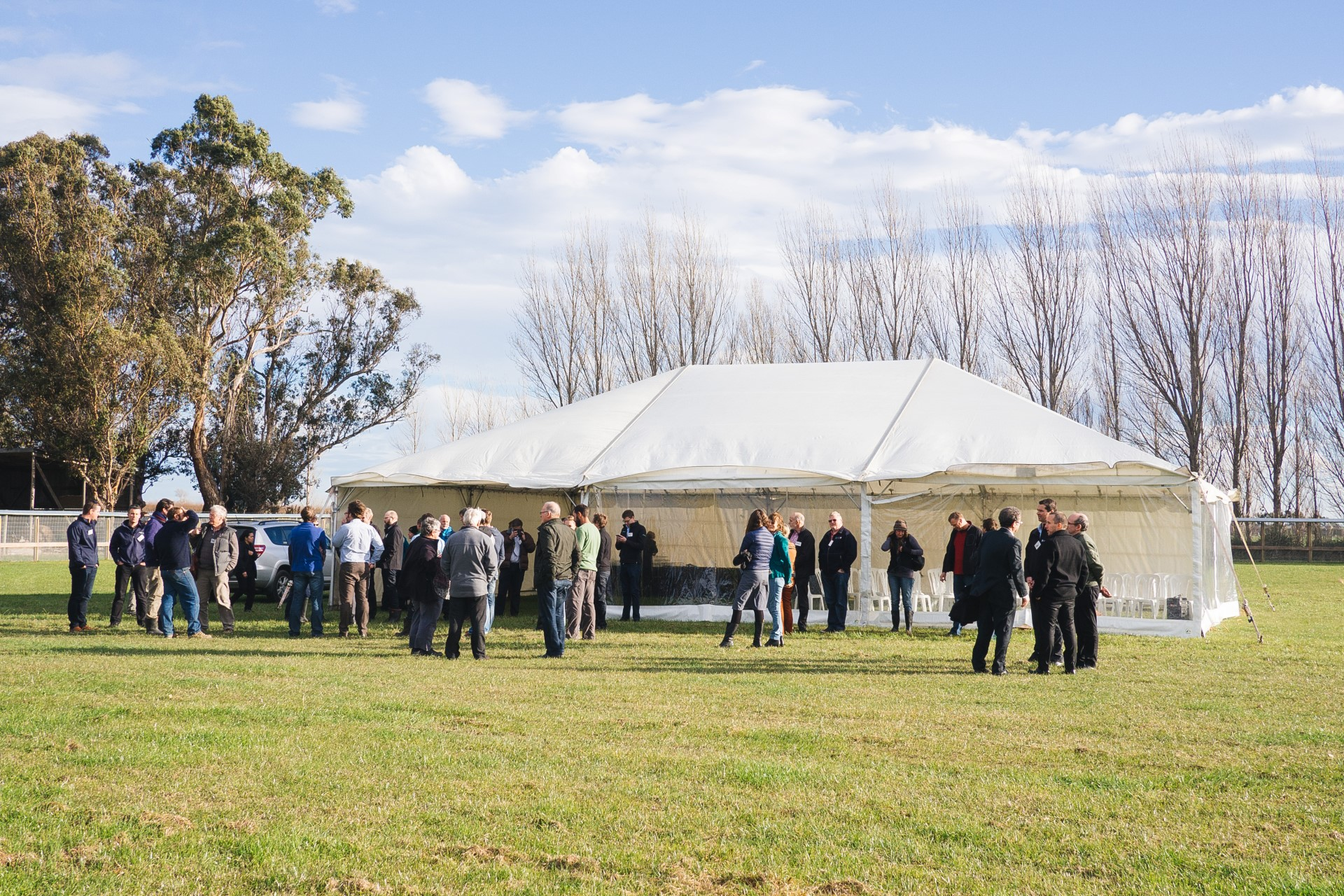 Attendees arrive at the enclosure.