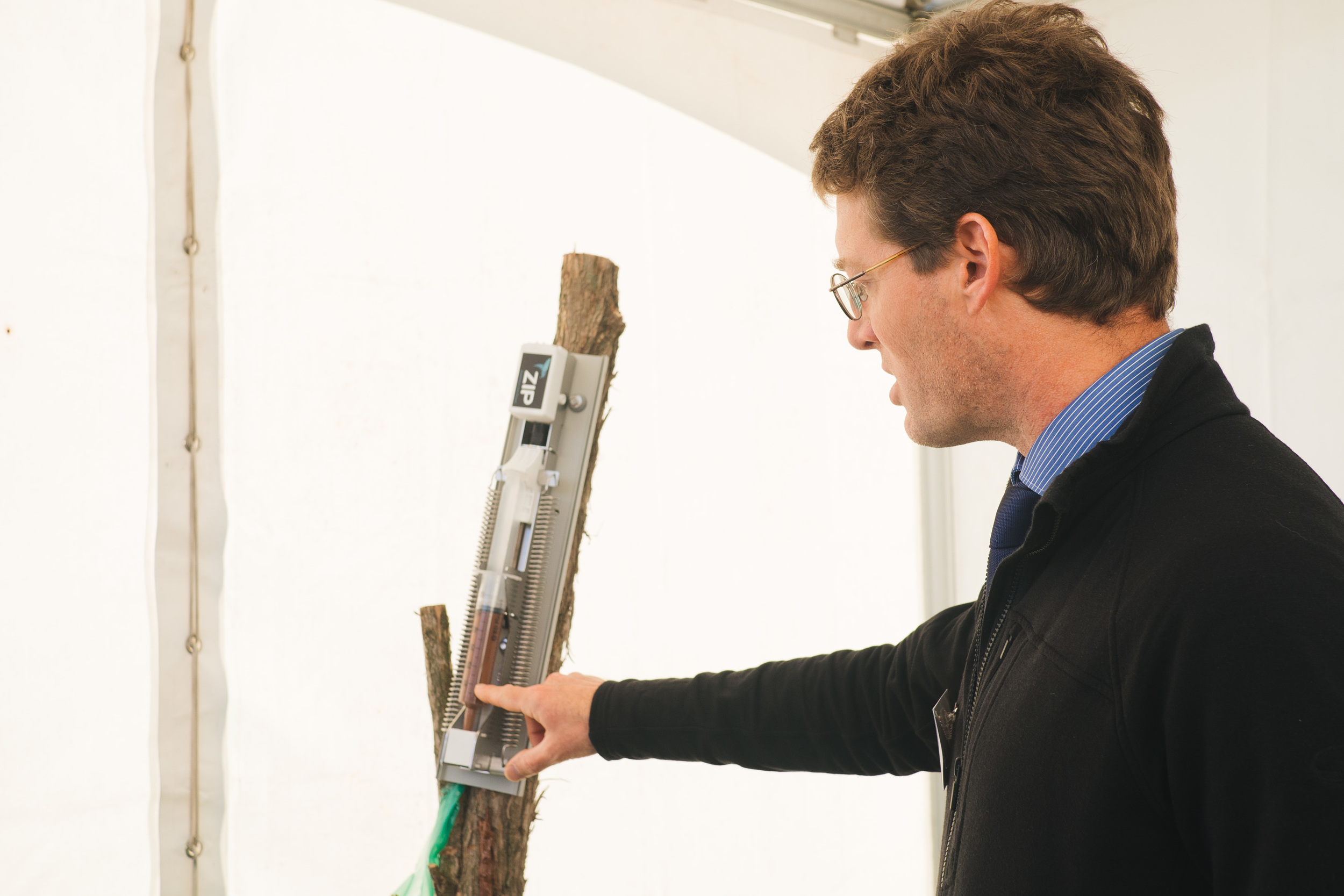 ZIP Principal Engineer John Wilks demonstrates the prototype automated lure dispenser ZIP is developing along with InFact Design.