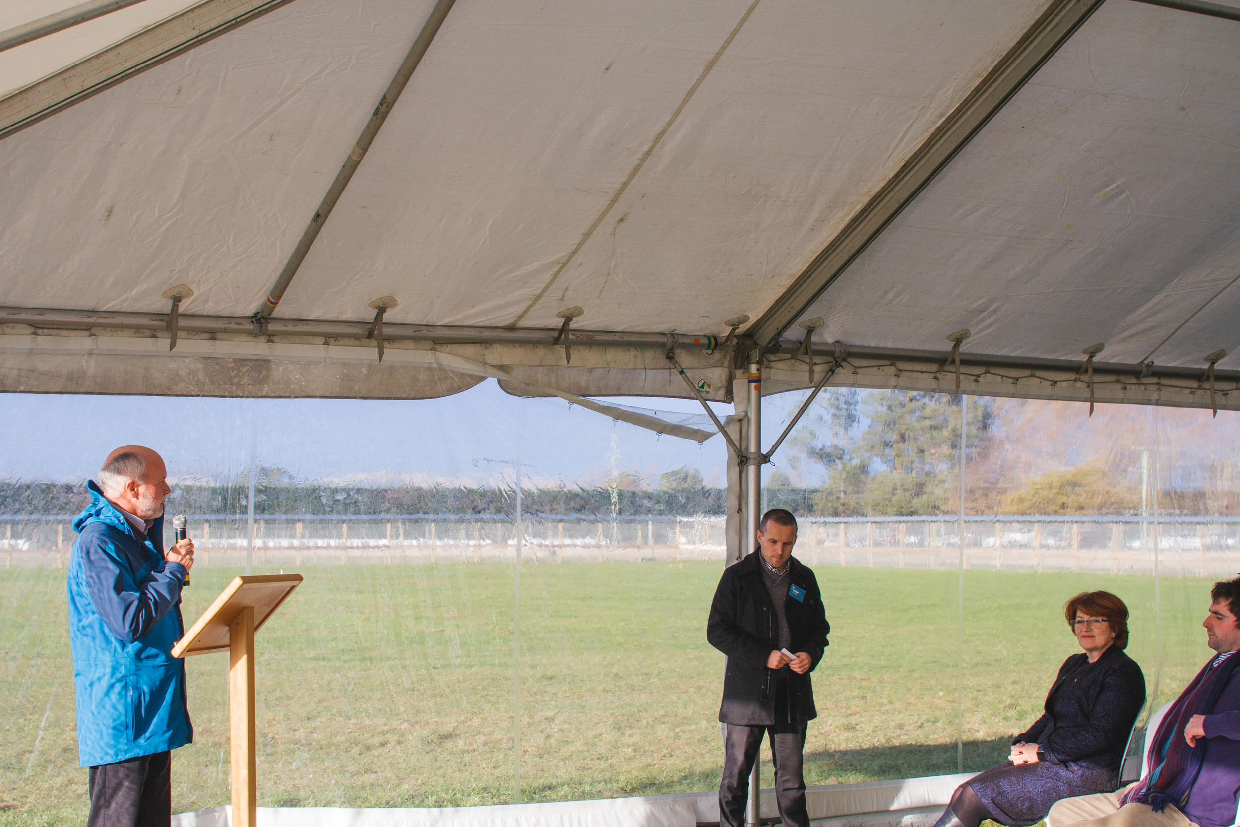 ZIP Board Chair Devon McLean addresses the group and thanks all those who made the enclosure possible. To his left stands ZIP Business Manager Phil Bell.