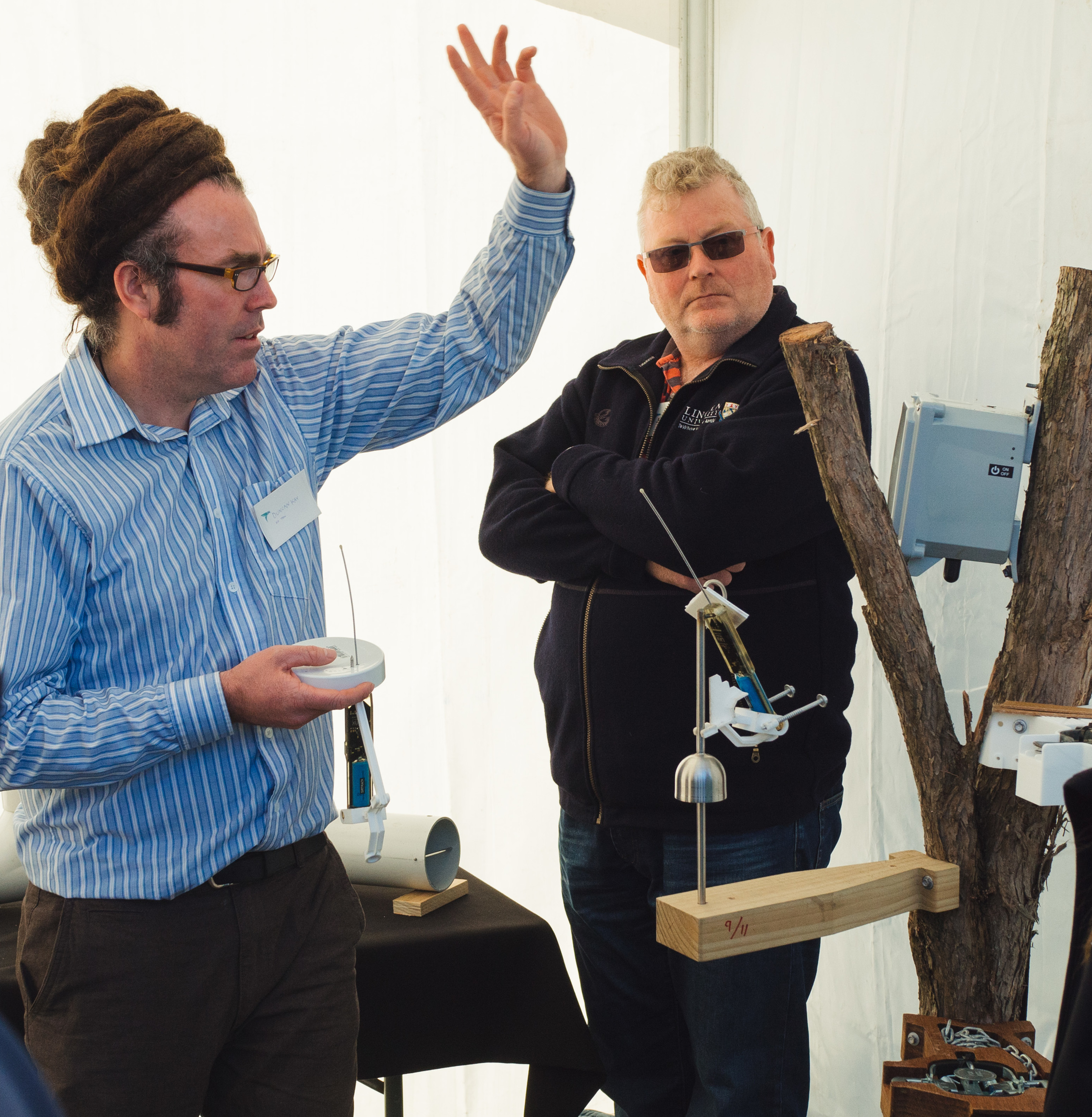 ZIP Field Team Lead Duncan Kay demonstrating the 'ZIP-tip' prototype automated detection device to Dr James Ross of Lincoln University.