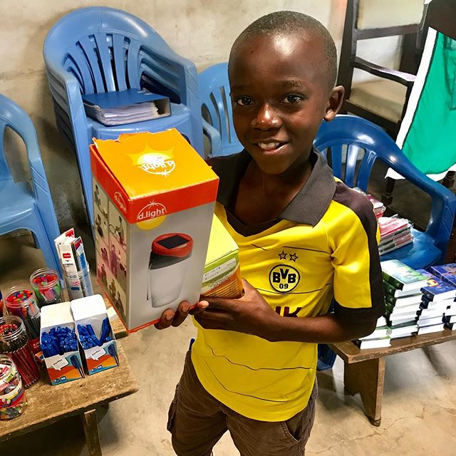 """Some happy """"shoppers"""" from yesterday's prize store. These kids worked hard at their memory verses and we're proud of them! The Most popular items this time were solar lamps and soya porridge—it's hungry season here. Pray that they would not only long for food,  but hunger for Gods Word."""