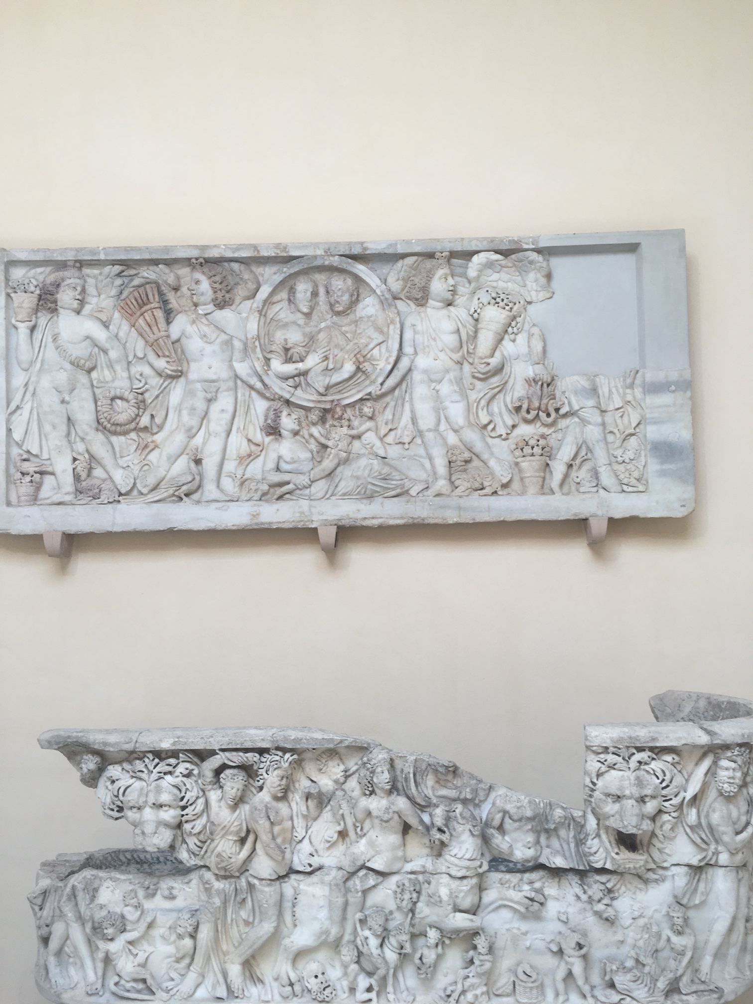 Sarcophagi and death sculptures hung in the museum. The museum is free to enter and is filled with random statues and frescoes, the archaeologists are always uncovering something.