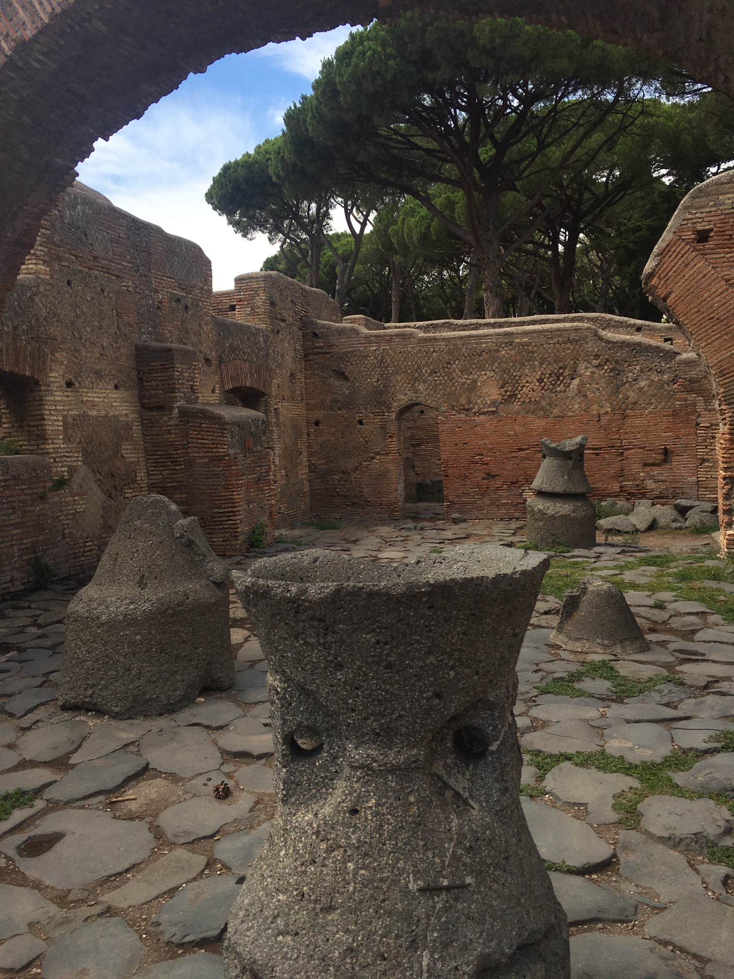 These lava stone contraptions were how they ground grain in the mills of Ostia. There were dozens of these, still exactly where they were 2,000 years ago.