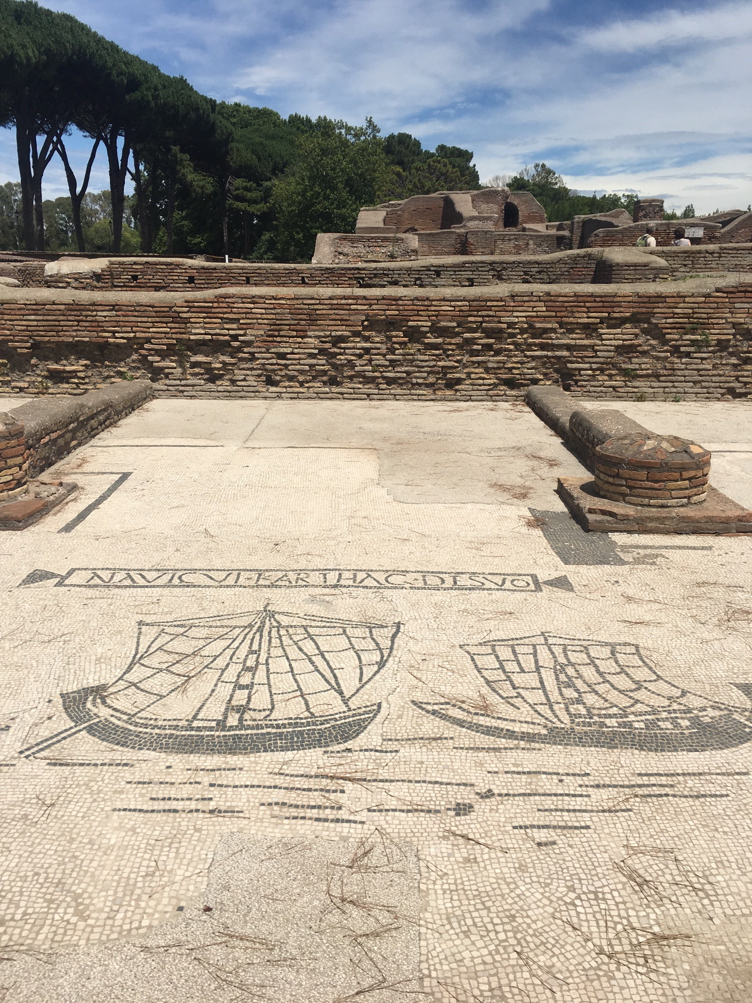 The main square of the town is surrounded by stalls, where the people of Ostia ran their businesses. Each stall had a fresco on the ground in front of it indicating what they did. This was a sailing company.