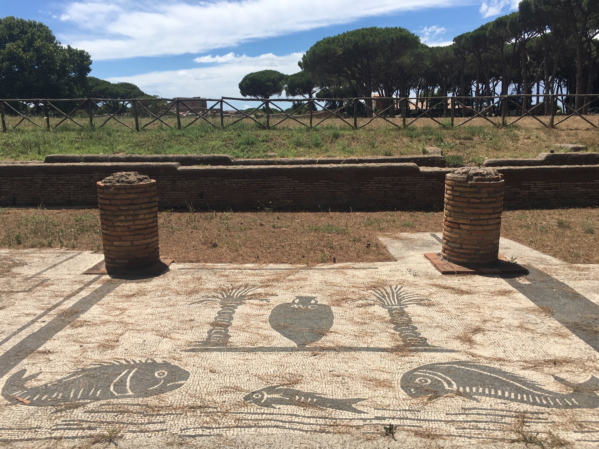 The main square of the town is surrounded by stalls, where the people of Ostia ran their businesses. Each stall had a fresco on the ground in front of it indicating what they did. What did this company do? Sell fish, maybe?