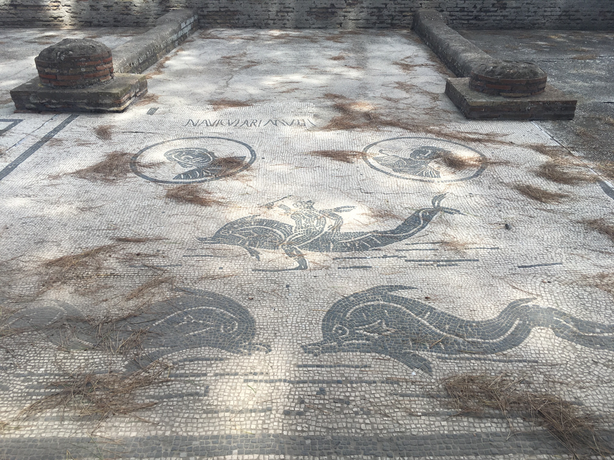 The main square of the town is surrounded by stalls, where the people of Ostia ran their businesses. Each stall had a fresco on the ground in front of it indicating what they did. Again, I'm not sure what these guys did....dolphin rides?
