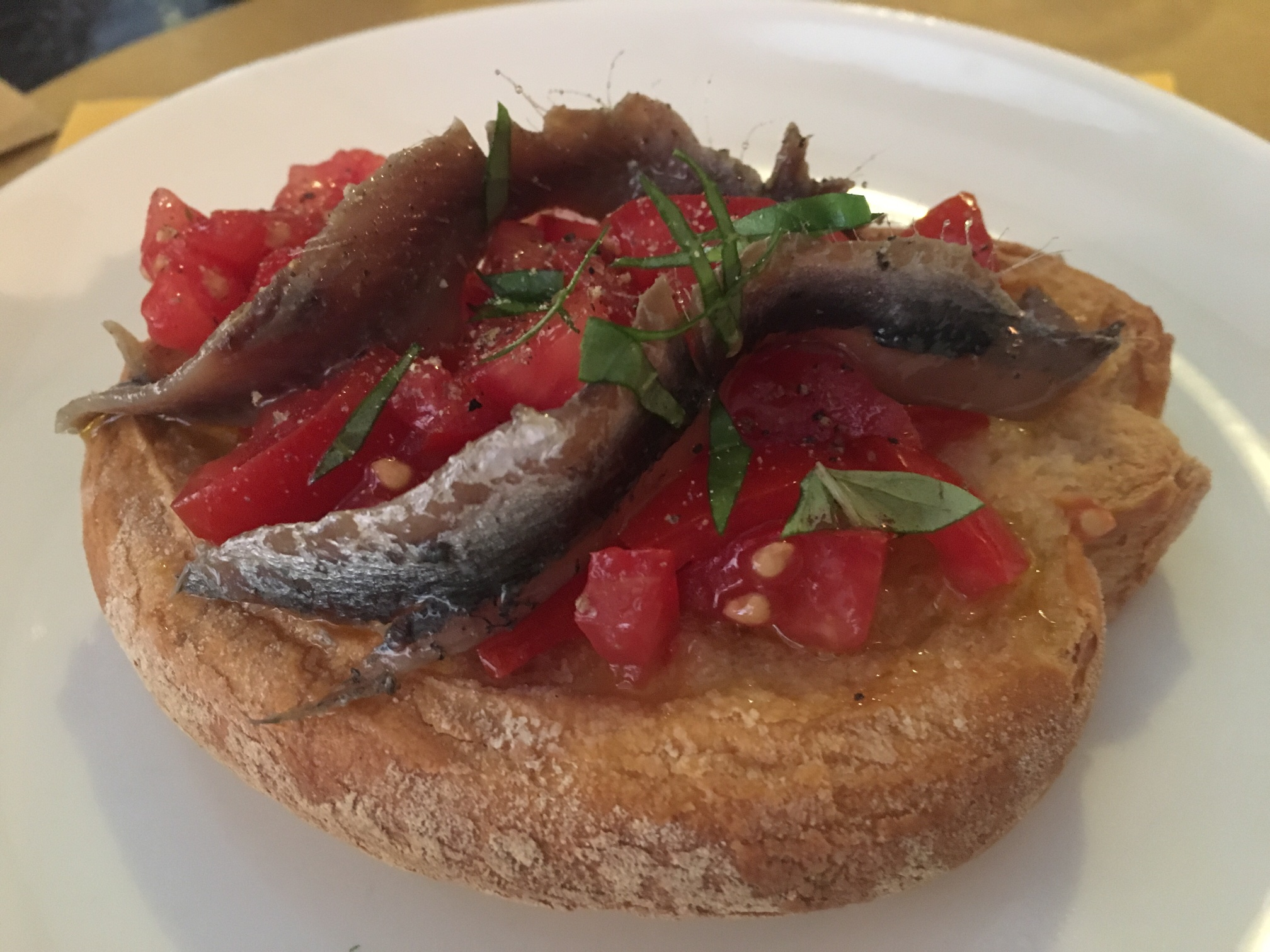 Local bruschetta with fresh caught anchovies. YES.
