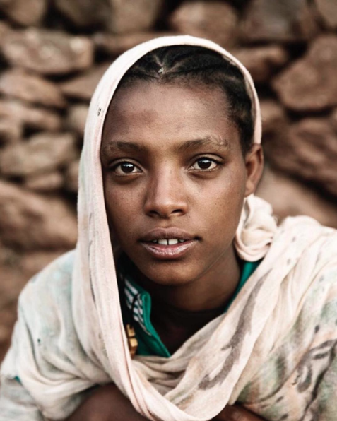 """A Face Like No Other"" by Malin Fezehai. Fezehai's work features arresting portraiture such as this image of an Ethiopian woman, and displaced communities around the globe."