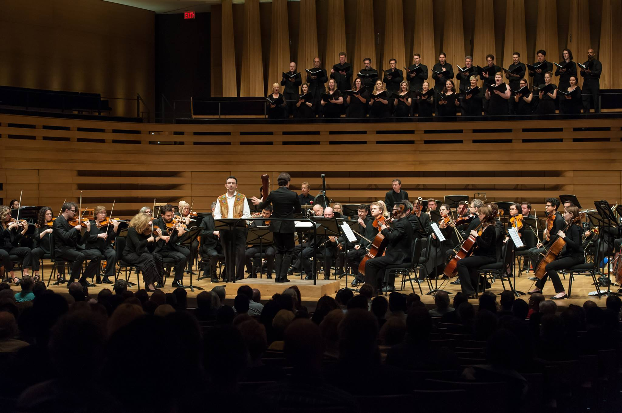 Author and Narrator Richard Van Camp in performance of Naka (Northern Lights) with the Canadian Opera Company Orchestra and Elmer Eisler Singers conducted by Johannes Debus at the 21C Music Festival