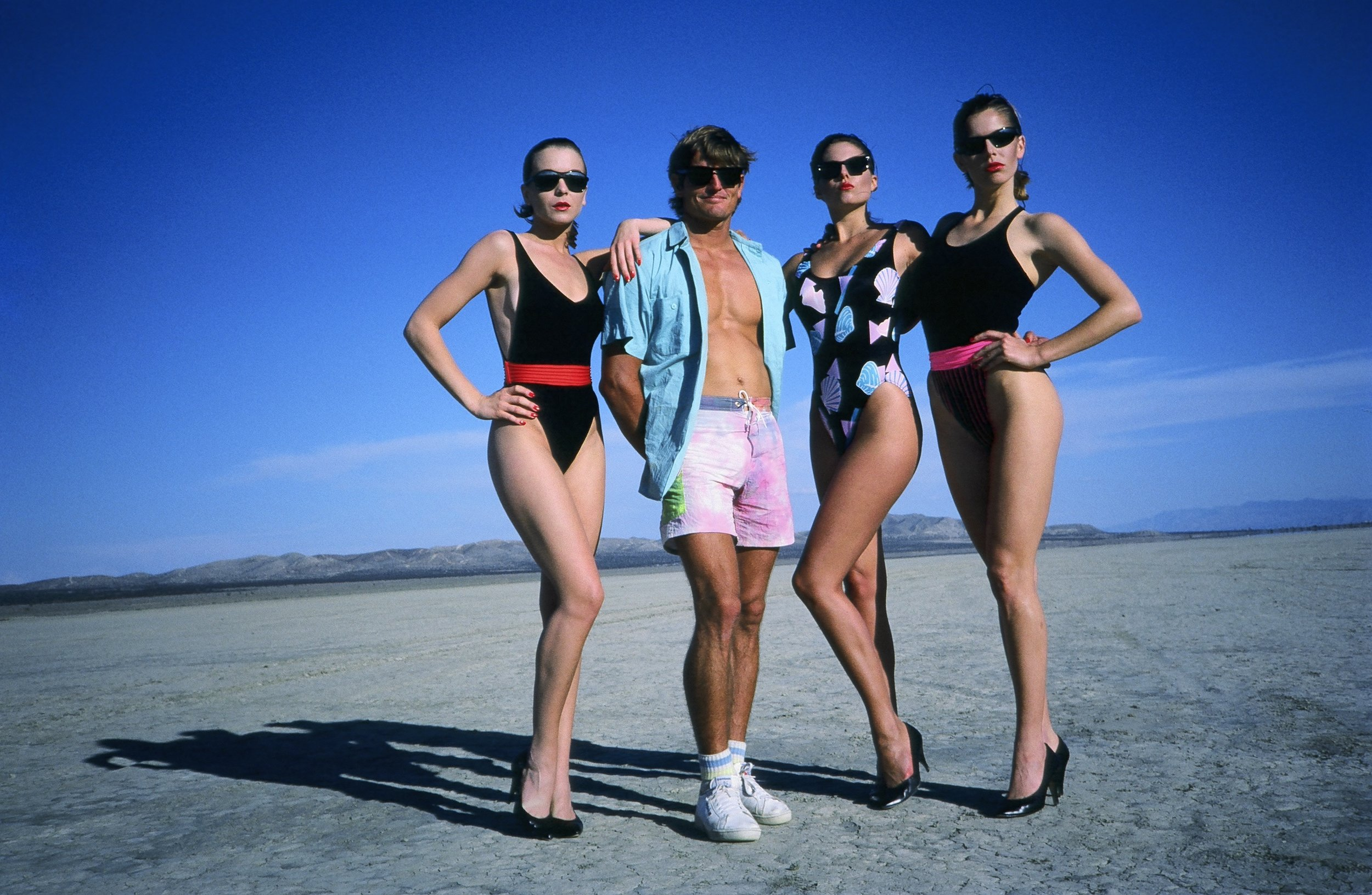Buzzy doing the Robert Palmer thing with three friends, somewhere out in the desert. If it all seems glamorous.... well, it was. Photo courtesy Buzzy Kerbox.