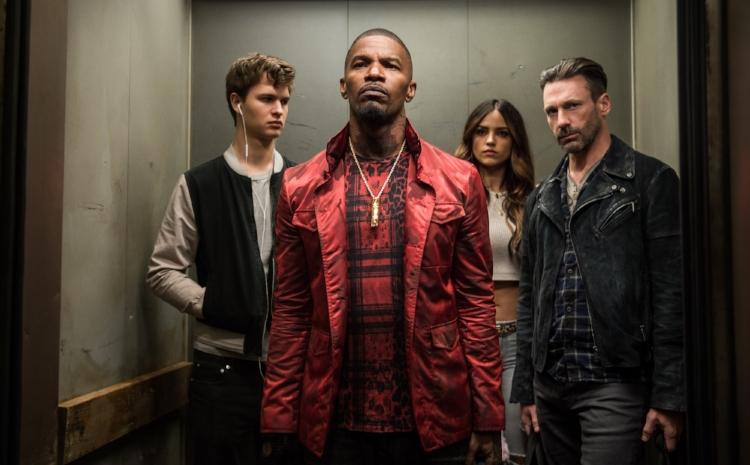 Ansel Elgort, Jamie Foxx, Elza Gonzalez and Jon Hamm enjoy a post-heist elevator ride in  Baby Driver.