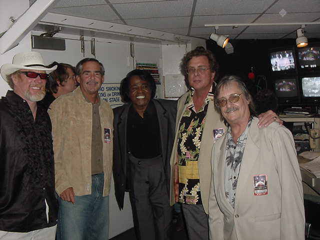 Backstage at the James Brown Revue. Hollywood Bowl, September of 2003. From left: John Dordero, Randy Hunt, The Godfather of Soul, Dennis Dooley and Surfari's guitarist Jim Fuller - the man behind the legendary  Wipe Out  riff..Photo: Ben Marcus.
