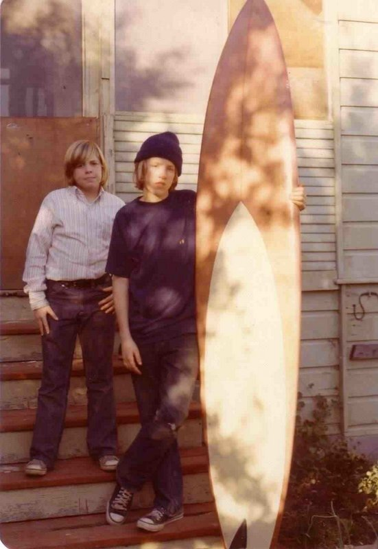 Moi with my beloved seven-foot Haut and my beloved Hang 10 shirt with my beloved brother Michael on the steps of our beloved house on Plum and Owen in the Seabright area of Santa Cruz. (Beloved bad wetsuit not shown)Photo: Mom.