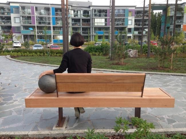 Hilda Kozári and her multisensory public sculpture, the  Pixtari  bench, in Leinelä Vantaa. Photo: Esa Vesmanen.