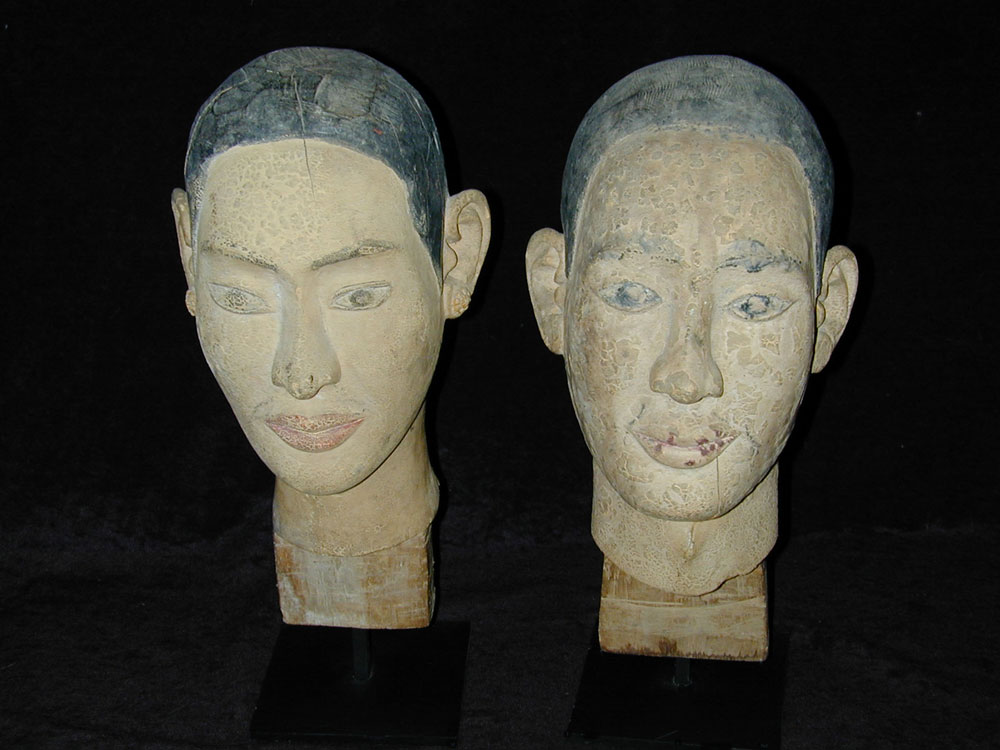 Sculpted polychromed wood heads of Mogallana and Sariputta, Burma, 18th/19th century.