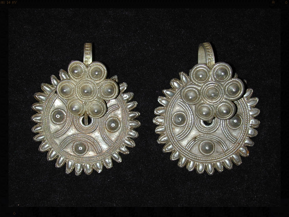 Yi silver earrings, China, early 20th century.