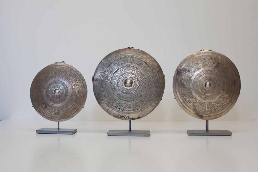Akha, Lahu or Lisu silver clothing ornaments, Burma or Siam, early 20th century.