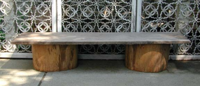 Low table of solid slab of old teak wood and cut antique wood water barrels.