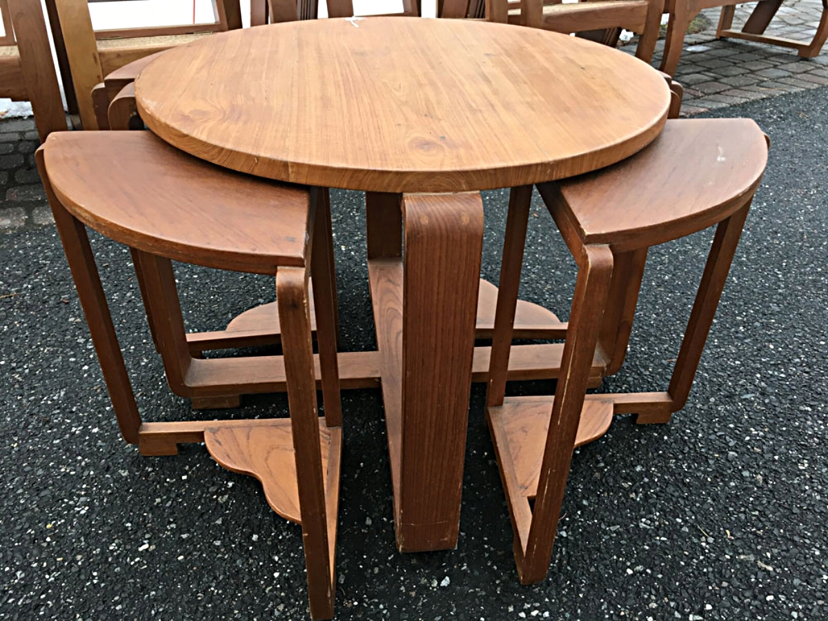 Teak wood table with four nesting side tables or stools, Siam, circa 1930s.