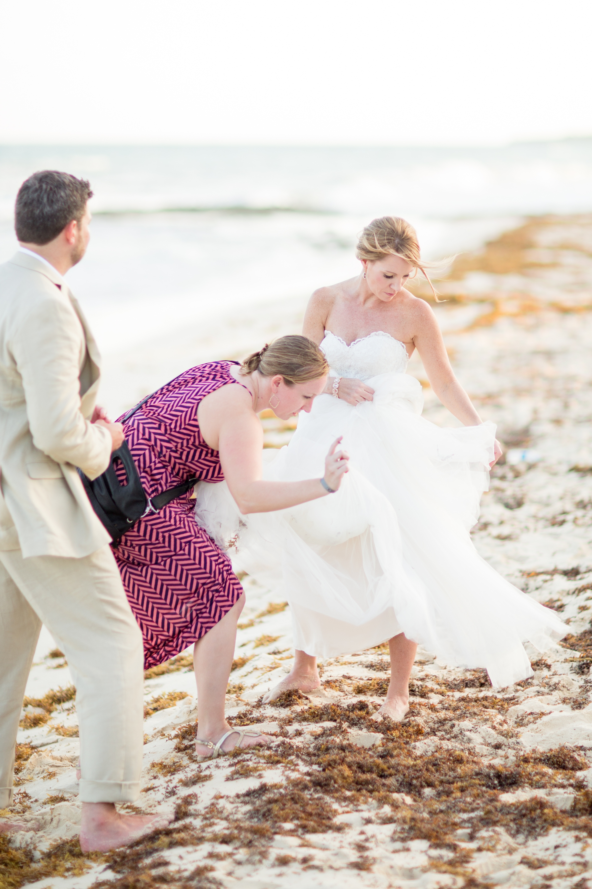 Trying to get some of the seaweed out of the dress!