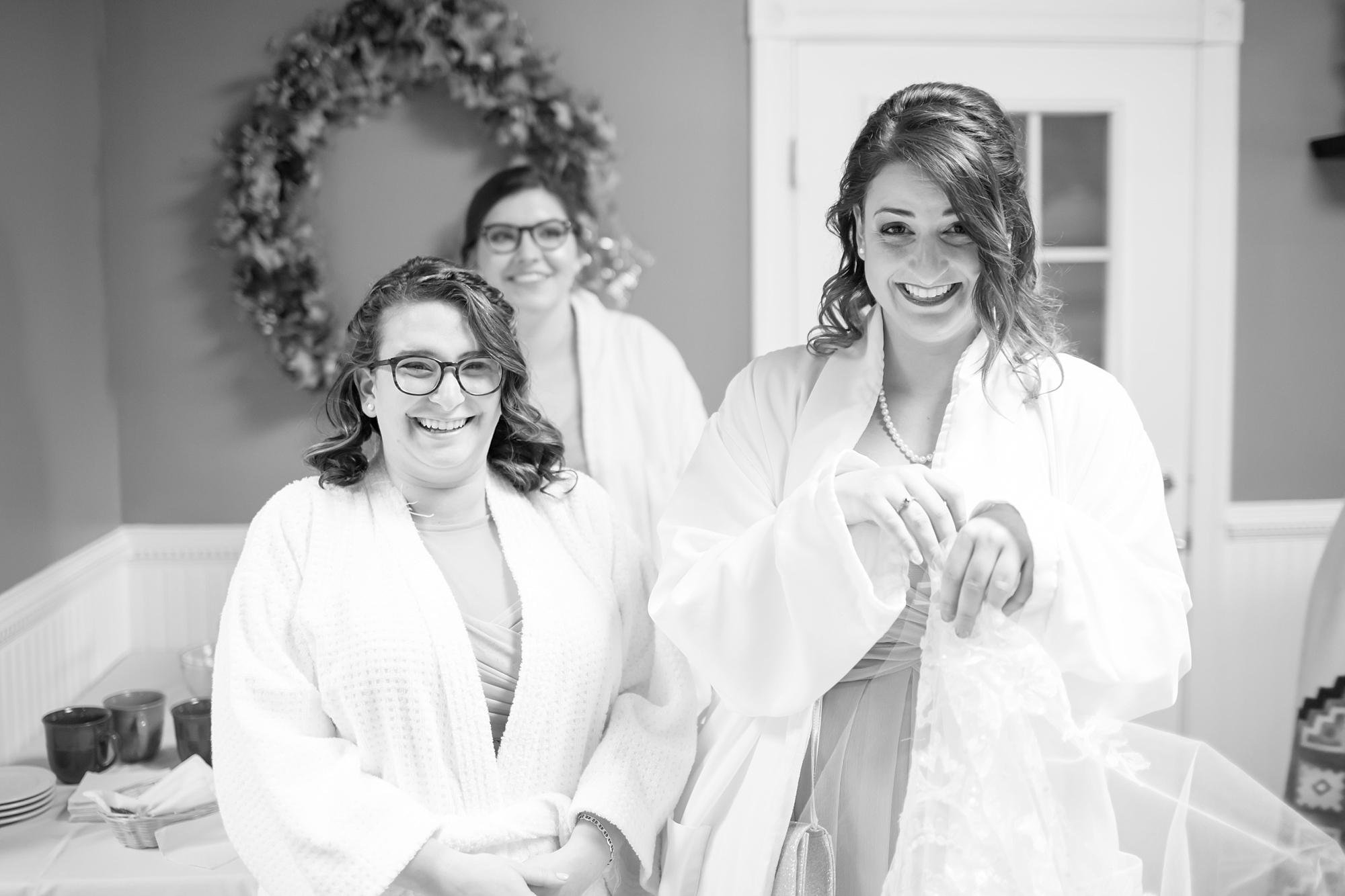 The girls were preparing for the windchill by wearing the robes overtop of their dresses!