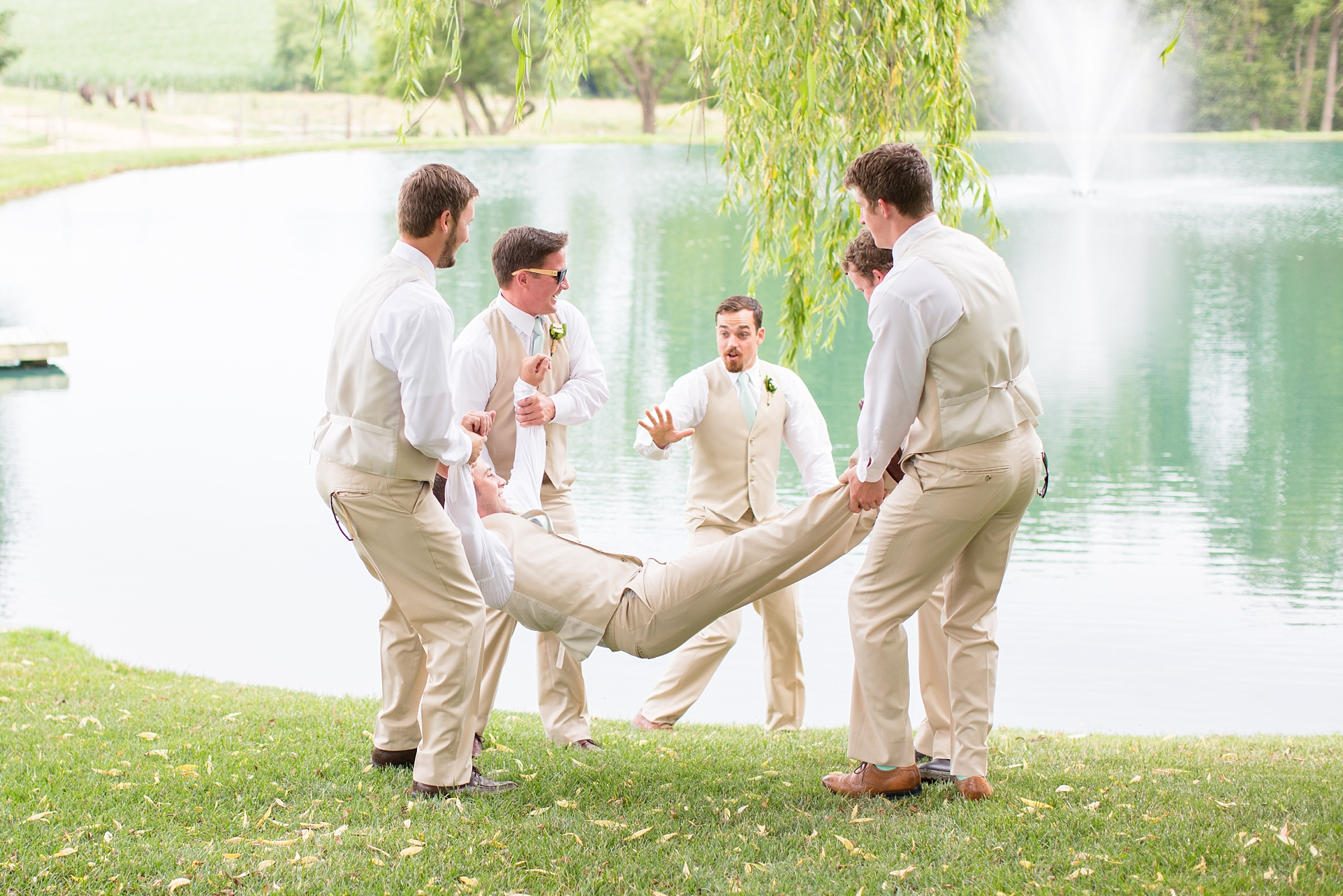 Throwing the groom in the lake! Just kidding!
