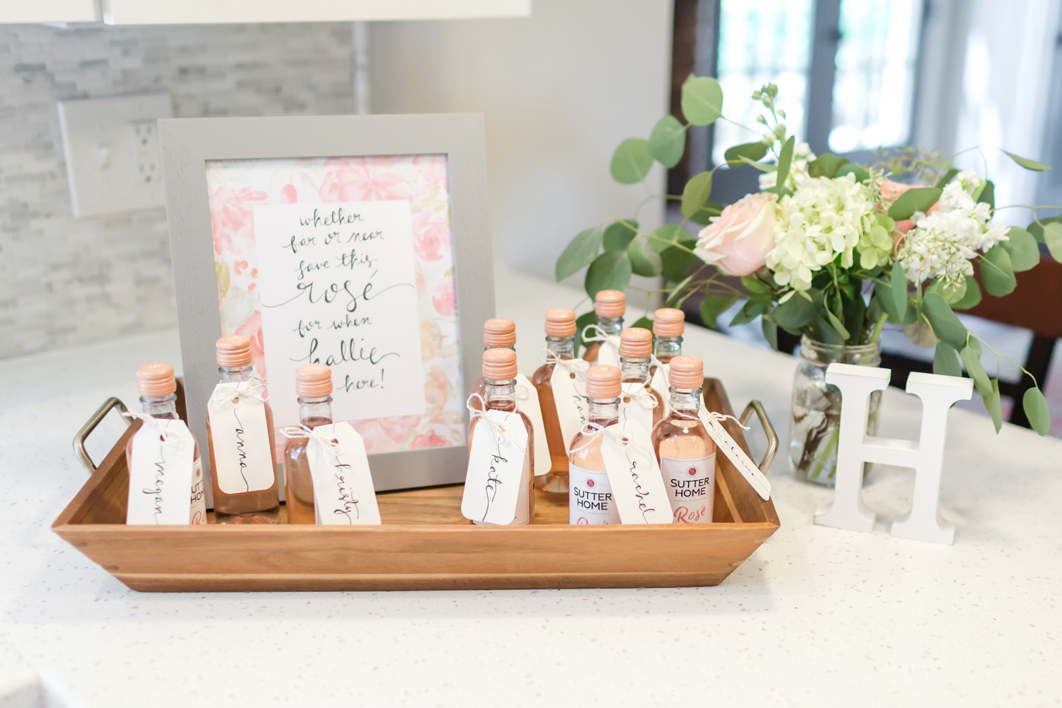 The favors were a cute little bottle of rosé for everyone to pop and drink in celebration when Hallie is born!