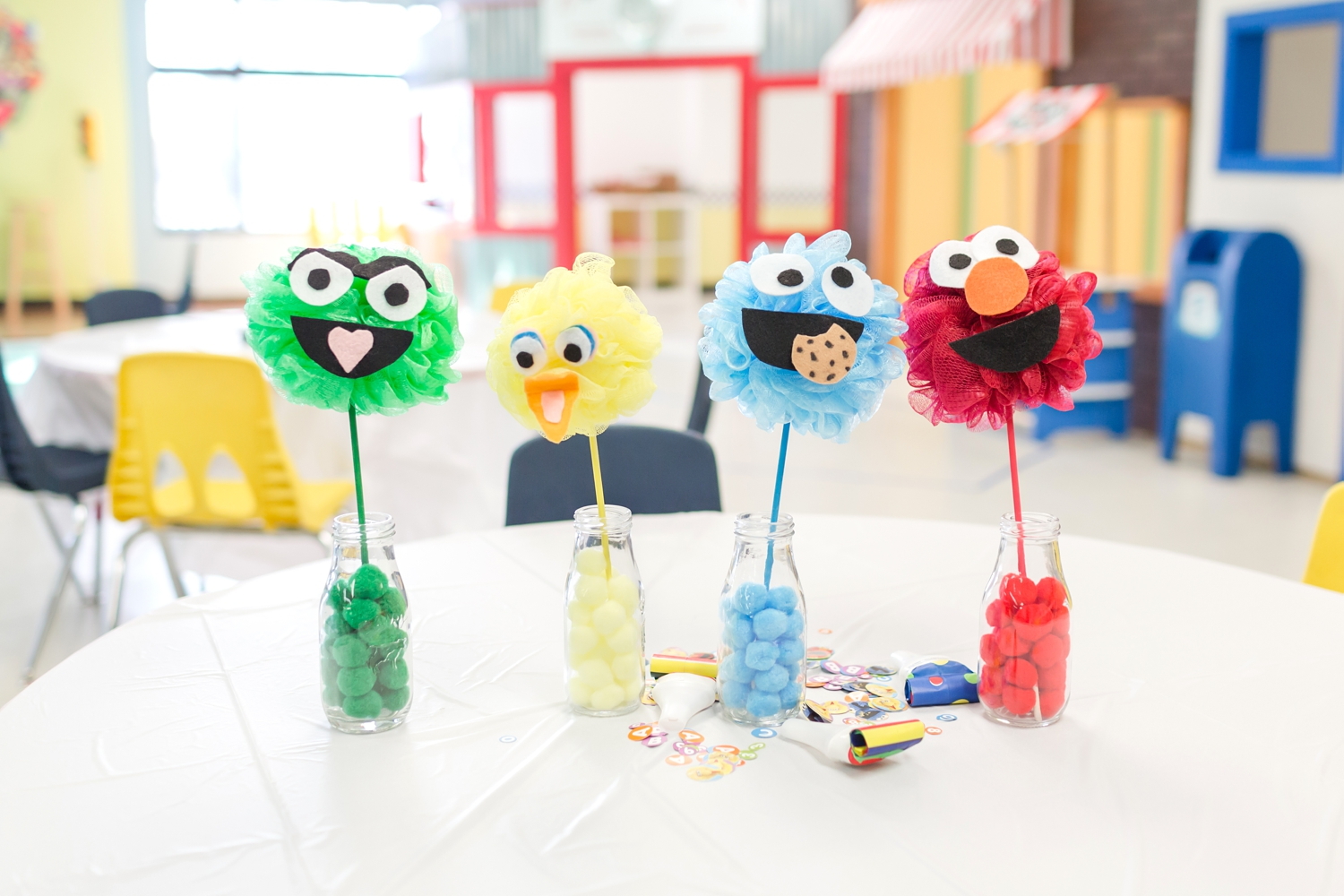 The beauty of pinterest! I combined two different centerpiece ideas I found with the pom-poms and loofa's. I made the faces from felt and painted the sticks and they were done!