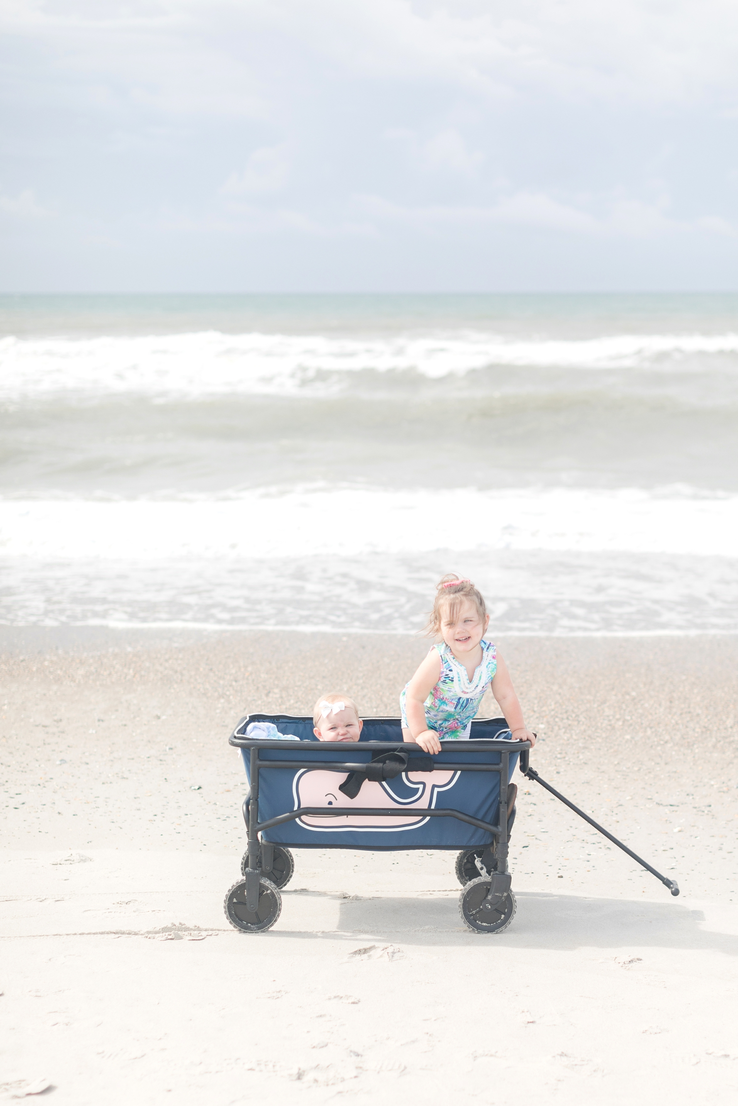 We bought a beach cart this year and this was the other amazing and necessary piece that we used everyday! It was nice because the kids can ride in it or you can put everything in there and not have to carry it all.