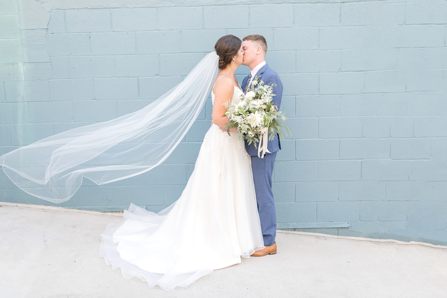 The blue wall matched their wedding theme! Love it.