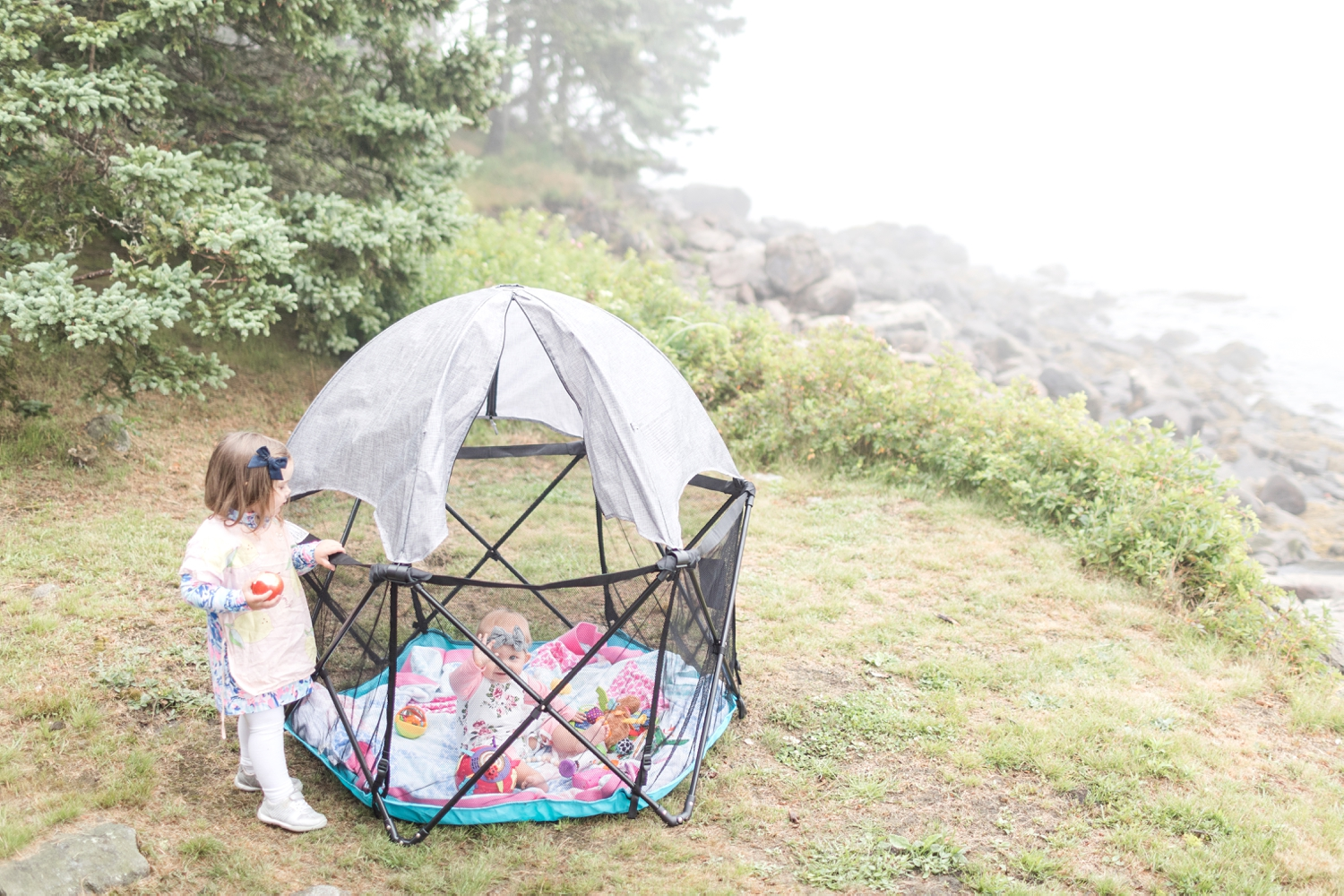 Having this outdoor play yard was amazing so Hallie couldn't crawl to the rocks!