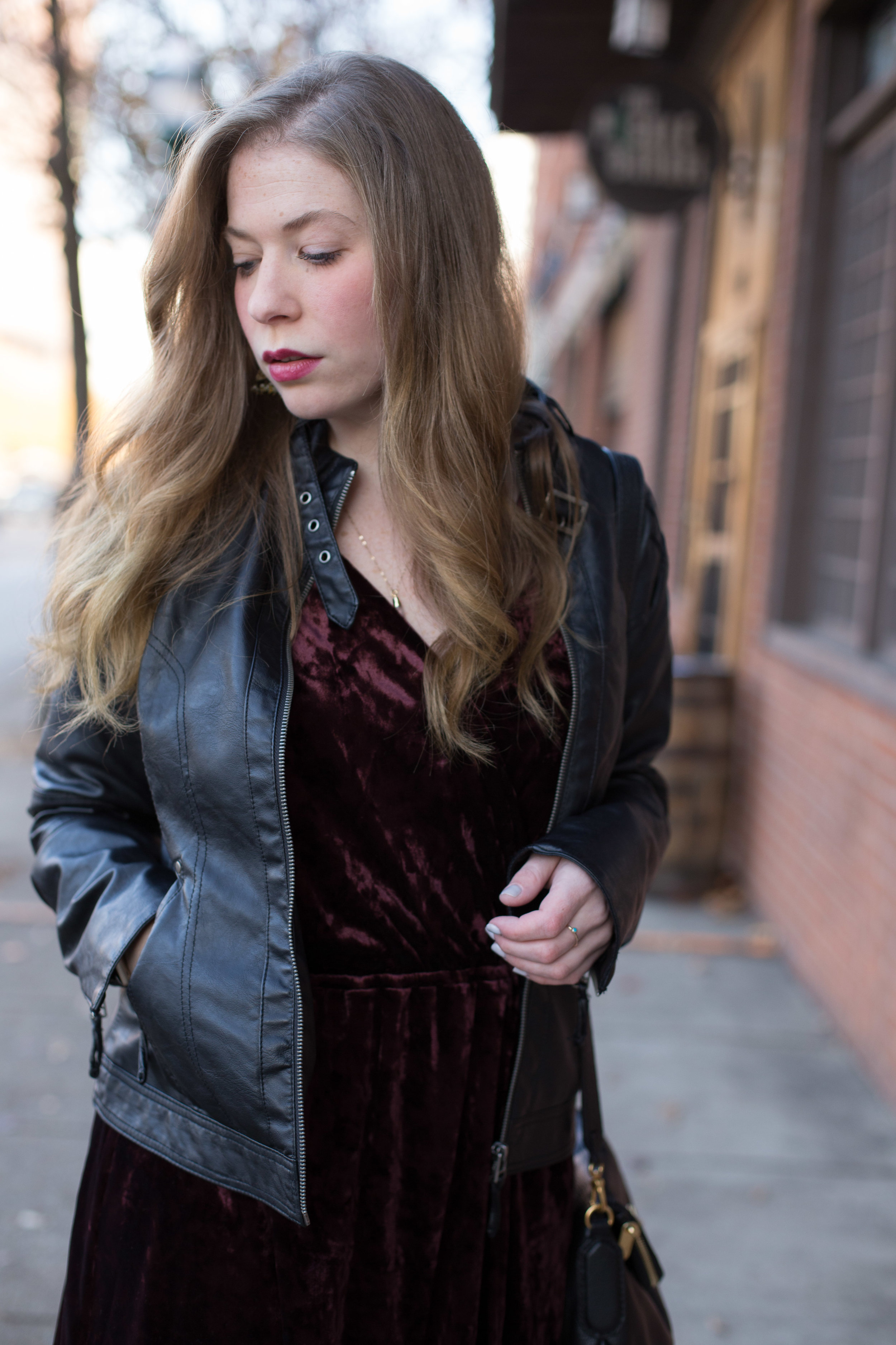 I am so in love with this deep red velvet dress! It's perfect for the holidays or for New Year's Eve. I like to pair it with my favorite leather jacket for a look filled with texture.