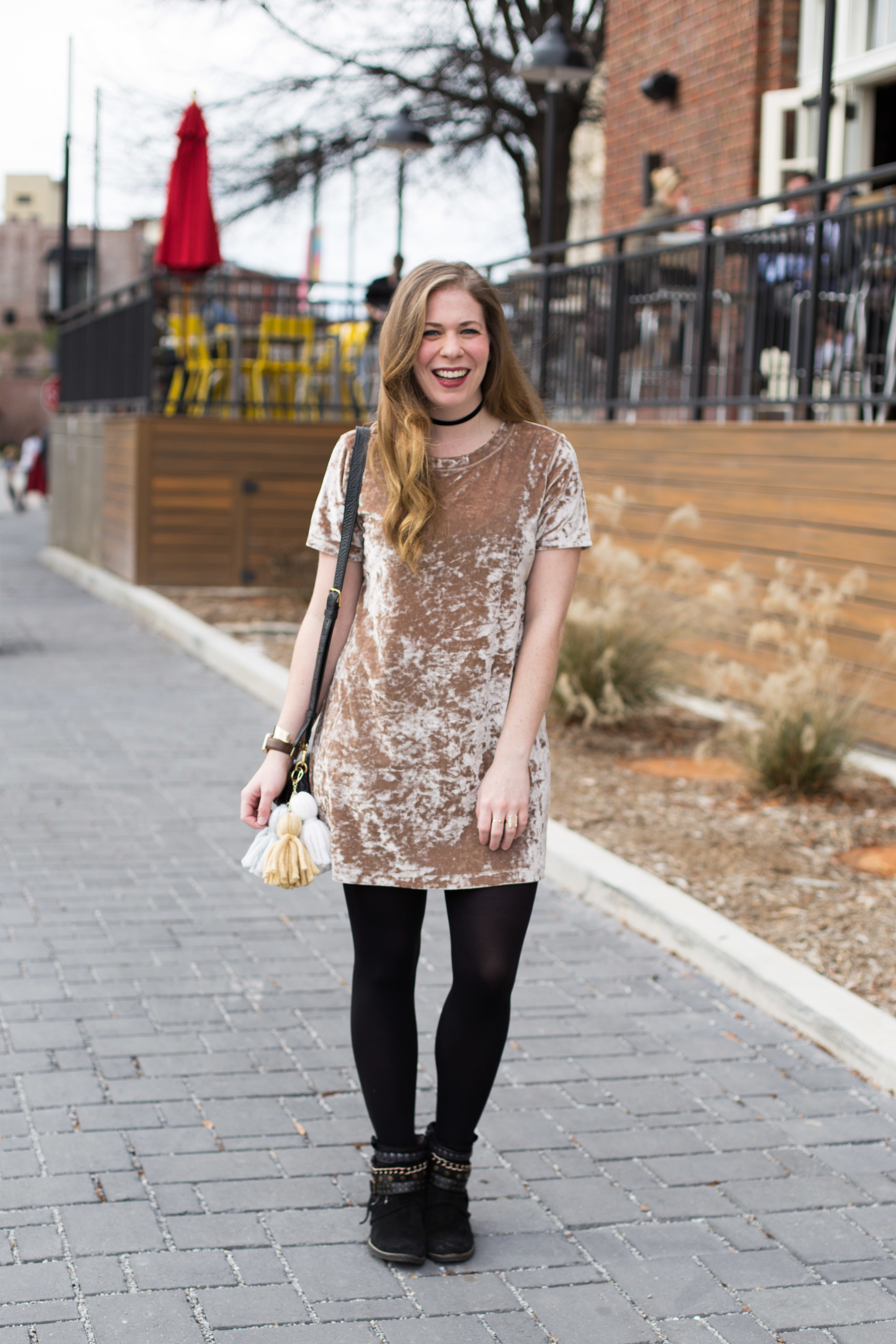 My favorite velvet shirt dress styled with black tights and funky boots + a handmade tassel DIY perfect for adding flare to your favorite handbag!
