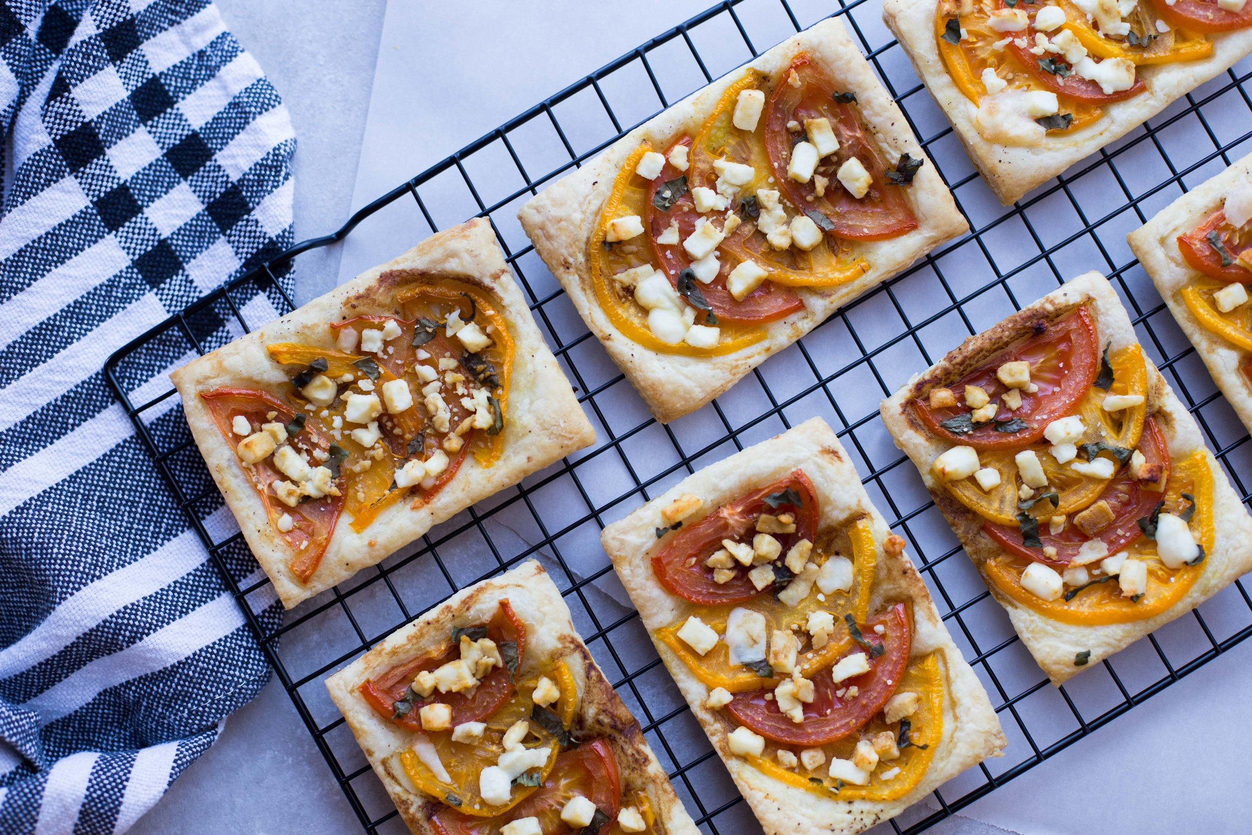 Summer Tomato Tarts with fresh basil, feta cheese, and balsamic drizzle.